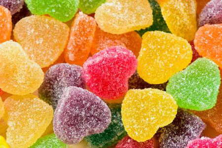 sugary: Colorful sugary candy heart shape background