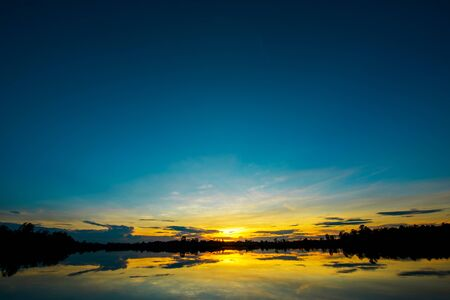 effect sunset: Breathtaking sunset landscape with clouds effect over lake