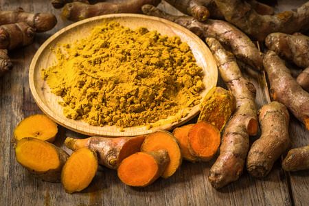 fresh turmeric roots with turmeric powder
