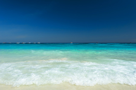 remote view: Refreshing tropical beach with blue sky