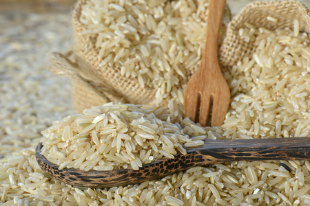 Closeup Brown rice in wooden spoon Stock Photo