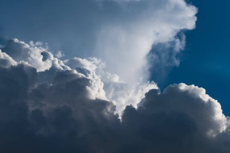 cumulus: Closeup Cumulus clouds on blue sky with sun beam