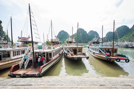 long bay: Ha Long Bay, VIETNAM - 21 August, 2016: Tourist junks floating among at Ha Long Bay Editorial