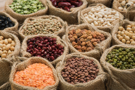 legumes: Vereous multicolor dried legumes in sack cloth