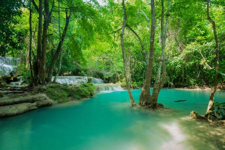 Beautiful and very nice green waterfall for relaxation, Erawan waterfall located Kanchanaburi Province , Thailand Stock Photo