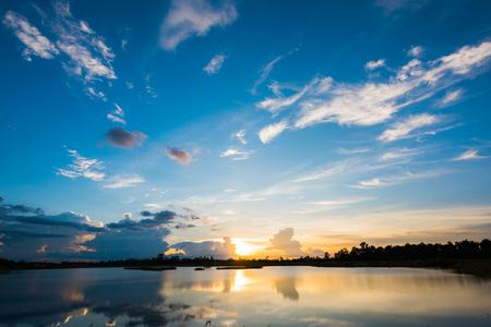 Breathtaking sunset landscape over lake Stock Photo