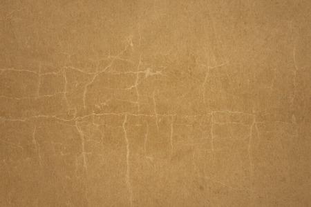 antiquarian: Old brown paper vintage background