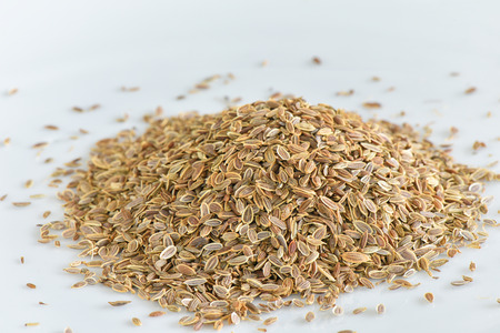 Dill seed on white background
