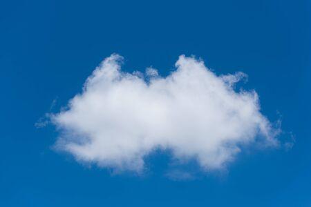 Single white clouds on blue sky