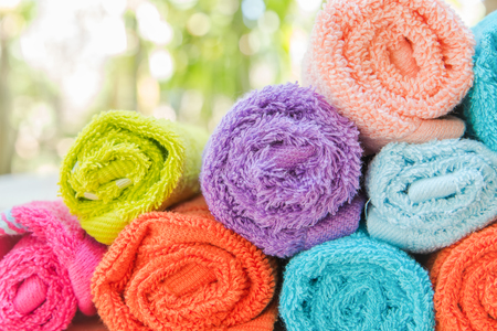 convolute: Roll of Multicolor towels use in spa health club Stock Photo