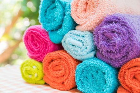 convolute: Closeup Multicolor towels with nature blur background