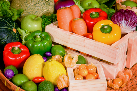 Various fresh fruits and vegetables in wooden container for eating healthy Stock Photo
