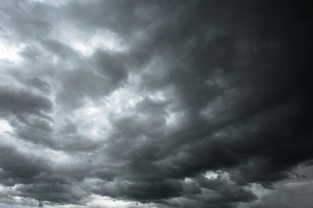 Dark sky and black clouds before rainy, Dramatic black cloud and thunderstorm