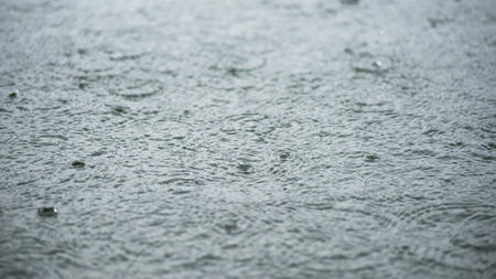 Motion and smooth water surface and rain impact