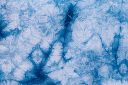 Pattern of blue tie batik dye on cotton cloth, Dyed indigo fabric background and textured, Painted blue watercolor on white cotton cloth Reklamní fotografie
