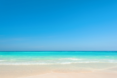 Beautiful blue sea and clear sky, Breathtaking tropical beach with white sandy and ripple wave