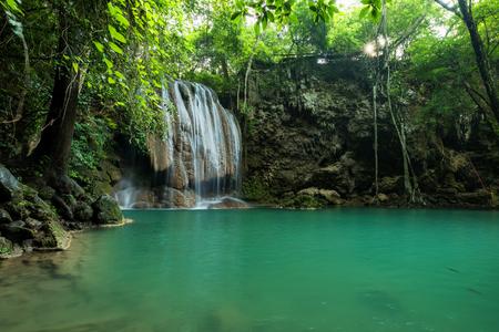 Breathtaking green waterfall at deep forest, Erawan waterfall located Kanchanaburi Province, Thailand