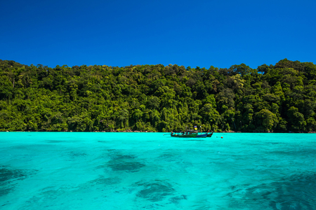 Blue and bright sea water surface at the open sea, Beautiful blue sea at Surin island, Thailand