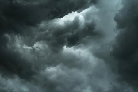 Dark sky and black clouds, Dramatic storm clouds before rainy, Closeup black cloud motion 写真素材