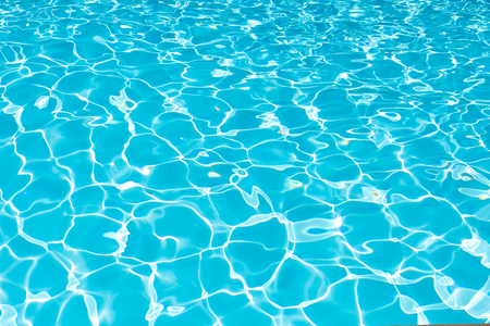 Blue and bright water surface and ripple wave in swimming pool