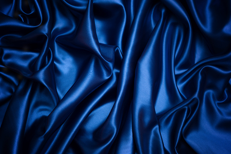 Blue fabric background and texture, Grooved of dark blue satin abstract