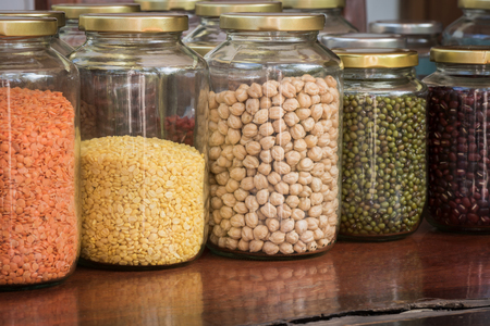Different dried legumes in a glass jar Banque d'images - 106165689