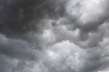 Weather in summer with black cloud and storm, Dark sky and dramatic storm clouds Stock Photo