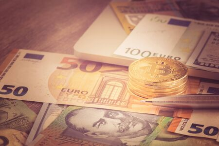 Bitcoin new virtual money with Euro and pen, Pen coin and banknote for business concept vintage tone Stok Fotoğraf