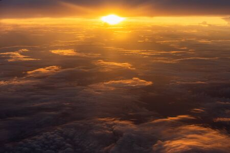 Beautiful sunlight and cloudy as seen through window of an airplane Standard-Bild - 132005225