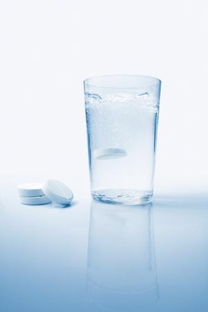 aspirin: And effervescent aspirin tablet boiling un a glass of water Stock Photo