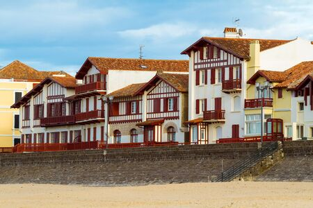 pays: Typical white and red buildings from Saint Jean de Luz, France, Pays Basque  Stock Photo