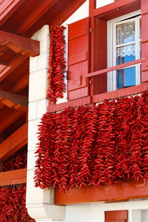 frontage: A typical basque frontage with bunches of drying red peppers