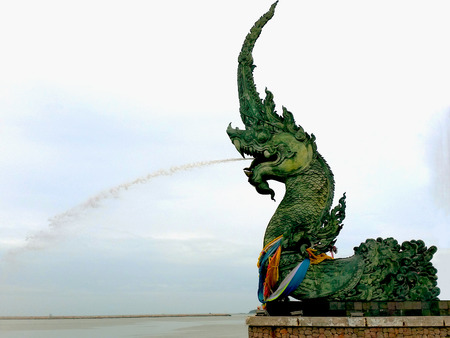 living things: The Great Serpent Naga in the beach of Songkhla sprouting water to the bay. Naga or Nag is the deity of the divine creation of water as well as fertility to all living things. The people of Southern Thailand believe that Nag sprays divine water so as to Stock Photo