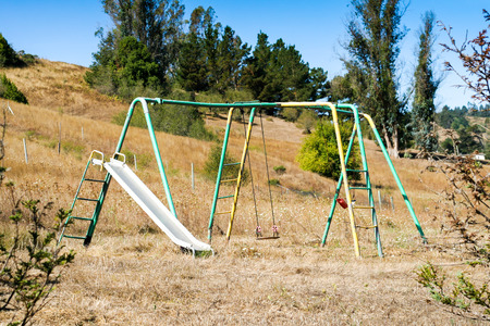 playground equipment: An old piece of playground equipment that has not been used in a long time. Stock Photo