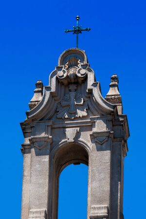 santa cross: Cross on top of the Saint Rose Parish with clear blue skies in the background in Santa Rosa California.