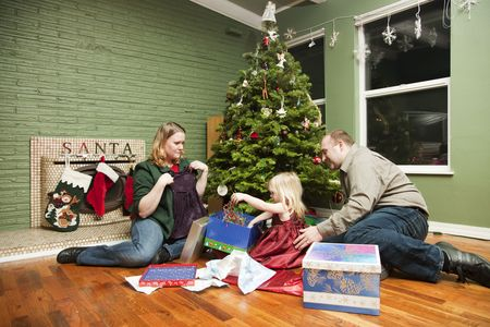 Family of three on Christmas morning Stock Photo - 4015795