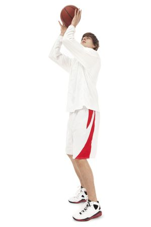 Photo of a teenage basketball player, catching the ball (slight motion blur)