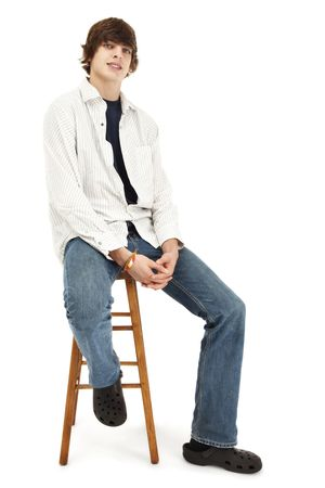 Photo of a casual young man, sitting on a wooden stool photo