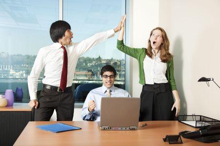 Three business colleagues celebrating a big success photo