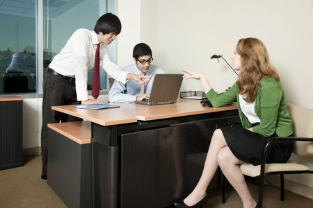 Three business colleagues in a meeting, discussing data. photo