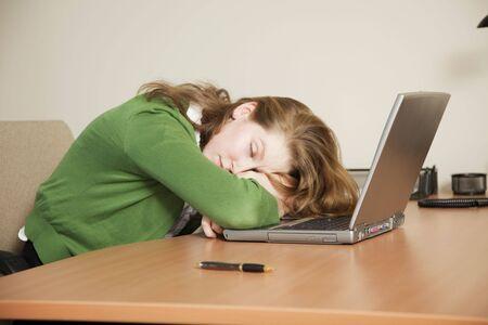 Businesswoman asleep at her desk. Stock Photo - 4285588