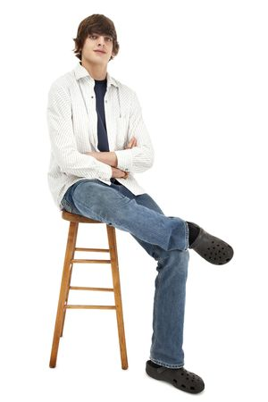 stool: Portrait of a casual young man Stock Photo