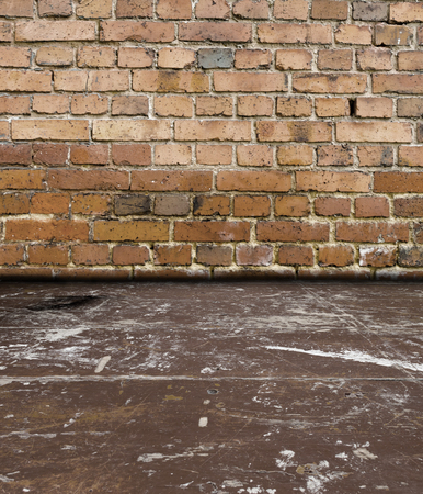 wooden floors: brick wall and wooden floors Stock Photo