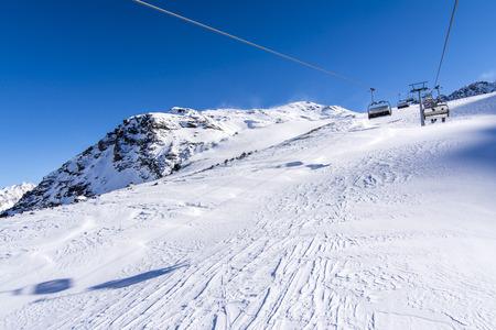 chair on the lift: Chair lift at mountain peak, Italy ski resort Solda Stock Photo