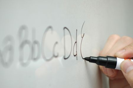 Writing ABCs on a whiteboard