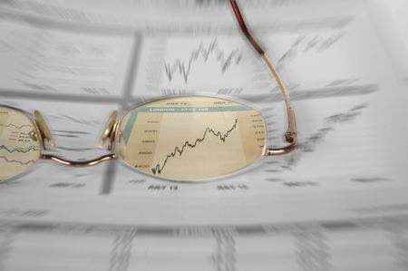 A color cut-out shot of a glasses over stock market graphs with extreme zoom effect