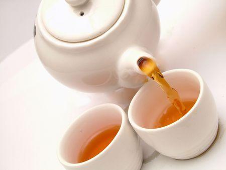 Pouring tea into tea cups