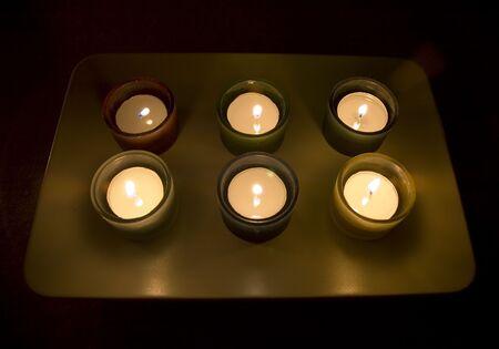 Six tea lights arranged and lighted Stock Photo - 250445