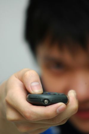 Male holding remote Stock Photo