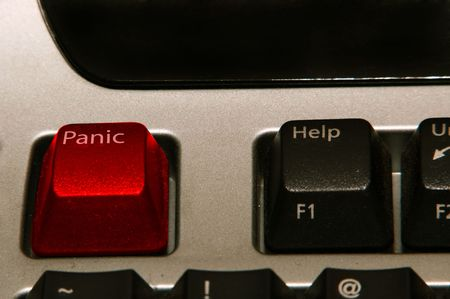 replacing: A red panic button on the keyboard replacing the escape button